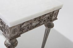 Claudia Console by Ebanista @ebanistacollect. Intricately hand-carved console table with antiqued and highly distressed Baroque Perle finish. Polished white Onyx stone top. Discover more at http://www.ebanista.com.