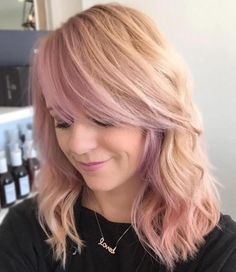 Pastel Ping Wavy Hairstyle With Side Bangs