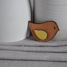 Origami Bird Brooch only €12.95 from ArtySmartyShop.com This origami style brooch is made from wood and then carefully hand painted in pastel colors and finished with a durable varnish. There are also matching necklaces, to go with these brooches.  #artysmarty #womensfashion #unique #fashionbloggers #handmadejewelry