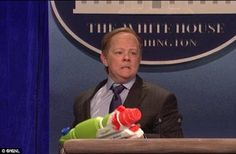 Laughing stock: Spicer's briefings have been parodied by Saturday Night Live with Melissa McCarthy playing the press secretary - and using a super soaker on the reporters