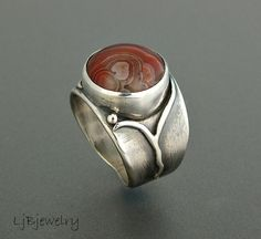 Agate and sterling ring by Ljbjewelry on Etsy I like the customized band.