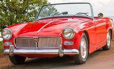 """Robbie: """"Here are some pictures of my 1962 MG Midget MK1 with its original 948 engine. A total renovation was done to this car using Moss Motors parts."""""""