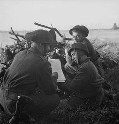 Infantrymen of The Black Watch (Royal Highland Regiment) of Canada purchasing Victory Bonds, South Beveland, Netherlands, 30 September 1944. (L-R): Privates M. Therrien, J.A. Laplande, R.F. Gallahan