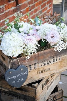rustic wedding stack 3 wooden crates and add flower to the top crate for a wonderful entrance display / http://www.deerpearlflowers.com/country-wooden-crates-wedding-ideas/