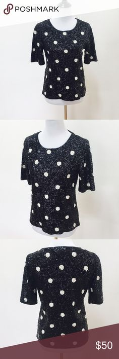 J.Crew sequin polka dot top All sequin polka dot black & white JCrew top, lining around inside collar for comfort, 100% cotton, PRODUCT DETAILS Two of our great loves—sequins and dots—are combined in one top that we're utterly wild about. Our design team carefully configured thousands of small sequins in a light yet dense layout to create a texture with a beautiful drape, then hand-finished the neckline and seams.  Slim fit. Cotton. Dry clean. Import. J. Crew Tops
