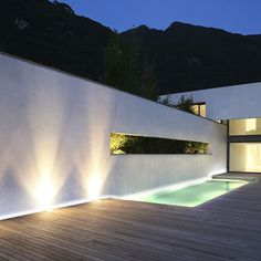 The addition of exterior lighting to the outside of a home can really transform how you perceive a particular element, be it the façade of the house or Swimming Pool Lights, Swimming Pool Designs, Swimming Pools, Deck Lighting, Exterior Lighting, Driveway Lighting, Concrete Wall Panels, Light Architecture, Garden Design