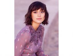 Wispy bangs in an eyebrow-length cut blend seamlessly into a textured bob.