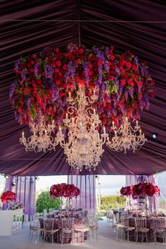 The most amazing floral chandelier | Photo credit: Michelle Mosqueda | Design credit:  White Lilac Inc | Purple and Red