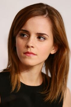 Emma even looks beautiful when she's throwing serious side-eye.