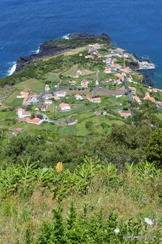 Fajã do Ouvidor and its natural swimming pools as seen from the miradouro on a walking trail.  Cick to learn more about São Jorge island, Azores