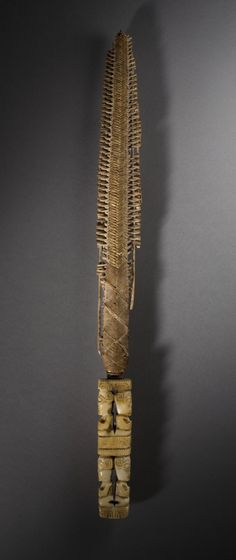 Fan Handle | LACMA Collections Fan Handle Marquesas Islands (Te Henua 'Enana/Te Fenua 'Enata), circa 1900 Tools and Equipment; handles Whale ivory and fiber 1 1/2 x 14 x 1/2 in. (3.81 x 35.56 x 1.27 cm) Purchased with funds provided by the Eli and Edythe Broad Foundation with additional funding by Jane and Terry Semel, the David Bohnett Foundation, Camilla Chandler Frost, Gayle and Edward P. Roski and The Ahmanson Foundation (M.2008.66.33) Art of the Pacific