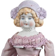 Lovely Bisque Lady with Molded Lavender Hat - 14.5 Inch Germany, circa 1895, this fine quality bisque shoulder head features a white molded blouse