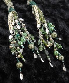 Handfasting cord in shades of green and cream, with Swarovski crystals and silver leaves on Etsy, $303.42 CAD