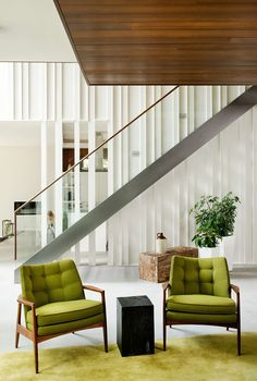 Custom staircase by Bättig Design and Thayer Coggin chairs in living room of Quebec retreat by boom town.