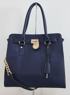 Michael Michael Kors Hamilton Large Tote Navy Blue Gloden. Some less than $100 OMG! Holy cow, I am gonna love this site!