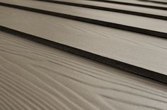 If it's time to replace your home's siding and you're looking for an alternative to wood or vinyl, it's worth looking at fiber-cement siding. One key advantage of fiber-cement siding is that it holds paint beautifully and longer than wood. Best of all, termites and fire both hate cement, so fiber cement siding provides a level of protection from the elements that wood and vinyl can't.