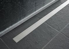 Ceraline flush linear shower drain from calfaucets.com allows for a curbless and fully accessible shower.