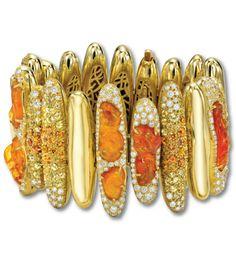 "The Nicholas Varney ""Pilar"" Bracelet. Elongated organic pieces of 18K gold united to showcase orange fire opals, yellow and orange sapphires and diamonds."