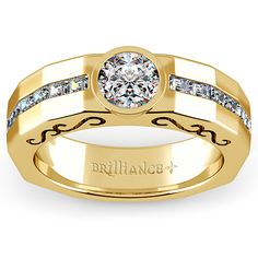 Orpheus Diamond Mangagement™ Ring in Yellow Gold - Love is the music of your heart, and nothing shows that better than Orpheus. Compose your journey with 1/2 carat total weight baguettes channel set alongside a 1 carat, bezel set center diamond. Featuring unique filigree cut-outs and a distinct angular design. Mangagement™ by Brilliance. Design by Dehlia Sprague, GIA G.G.