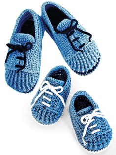 """These slippers and booties look like a pair of tie shoes and work well for men, women and babies. They are perfect for """"Mommy and me"""" looks too! Booties are written in sizes 0-3 (3-9, 9-12) months and are made using a DK-weight yarn. The slippers are written in adult shoe sizes 5-6 (6-7, 7-8, 8-9, 9-10, 10-11) and are made using worsted-weight yarn. Written instructions as well as step-by-step photos are included in the pattern."""