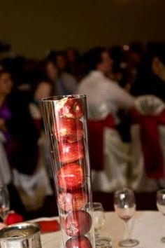 red apples in clear cylinder vase...