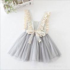 Looking for a unique flower girl dress? We can't get enough of the Amelie Dress! The perfect tulle and lace special occasion dress for any adorable little girl. Check it out at http://www.littletrendsetter.com/collections/girls-dresses/products/amelie-dress?variant=11876046468.