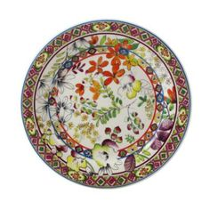 """Rows of bright geometric designs and playful florals decorate this exuberant earthenware collection from Gien France. 