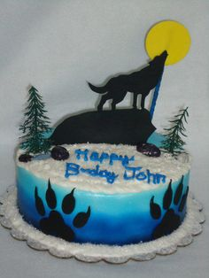"""8"""" chocolate cake covered in buttercream and then airbrushed. Fondant accents, chocolate rocks and plastic trees."""