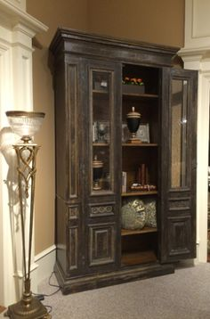 Such a great selection of #oneofakind pieces are on display on the #WHLuxe #salesfloor. #DougRuggles is showcasing in this lovely room a fabulous #armoire from Italy constructed from #Vintagedoors and #cabinetry built around them. SIMPLY STUNNING! #Rustic #RusticFurniture #Cabinet #ItalianCabinet #LuxuryFurniture #Furniture #HomeDecor #Home #Decor #HomeDesign #Design #InteriorDesign  For more information visit www.WHLuxe.com