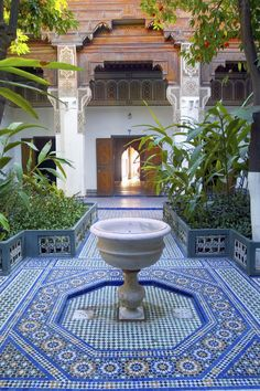 Marrakech, Morocco If you're looking for exotic adventure, add the Red City to your list. The bustling North African mecca includes over a dozen souks plus palaces, world-class gardens, and the Atlas mountain range. Moroccan Garden, Moroccan Decor, Moroccan Style, Moroccan Design, Beautiful Places In The World, Most Beautiful, Le Riad, Marrakesh, Marrakech Morocco