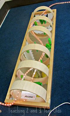 A mirror, blocks and a rope of light - a very inviting provocation {from Teaching 2 &3 Year Olds}