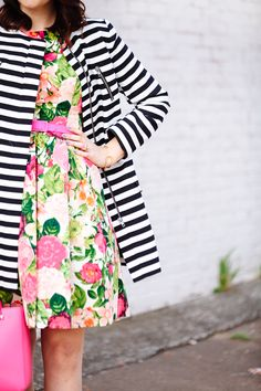 bold striped jacket and floral dress