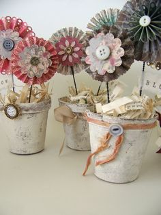 Peat Pots painted or decoupaged could make cute wedding favors with candy added inside.
