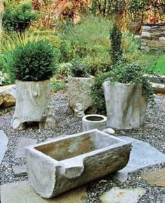 These faux bois stump containers were created by the author, who warns that some Texas pieces and those imported from Asia will not survive outdoors in far-north winters, where freeze-thaw cycles crack and destroy thin concrete.