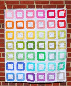 Raw Edge Pez Baby Quilt by Megan, an original design on her blog. She also has a nifty tutorial for you to make this one yourself.