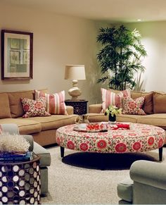 (Love the ottoman and the matching throw pillows as accent) Suzani. Coffee table love!