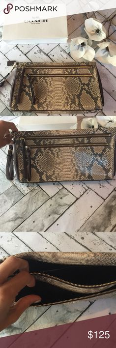 NWT SNAKE Clutch Brand new with tags authentic COACH clutch purse. Beautiful snake skin brown leather. Darker brown leather trim and finished with gold hardware. Double zipper front openings with plenty of storage space.  Comes in Coach Gift Box  Coach Bags Clutches & Wristlets