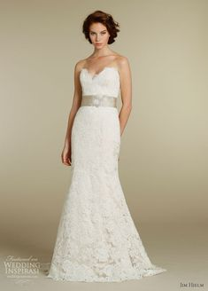 Jim Hjelm - 2012. Ivory Alencon lace over Champagne charmeuse modified A-line bridal gown with strapless sweetheart neckline, Champagne moire ribbon with crystal applique and sweep train.