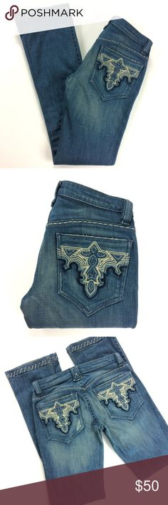 """Antik Batik Demin Blue Jeans Size 26 High end Bootcut blue jeans by Antik Batik Denim.  Embroidery detailed pockets, hems and seams.  Slight wear on hems as seen in photos but in fairness, the jeans are already distressed so it is hard to tell what is actual wear vs. manufacturer distressing.   Size 26 with an inseam that measures 33"""".    J01825001 Antik Batik Jeans Boot Cut"""
