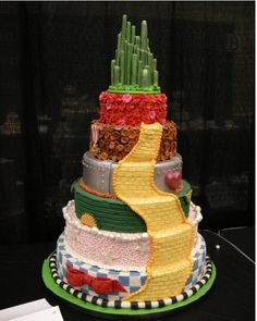 Wizard of Oz cake. SO AWESOME!!!  Each layer means something from the movie all the way down to the colors and patterns!