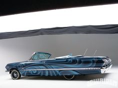 Rick Rock, owner of Low Life Hydraulics, has over 16 years of Lowriding under his belt, and his 1963 Chevrolet Impala Convertible keeps taking names on the streets and at car shows. - Lowrider Magazine