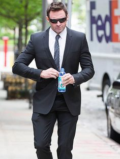 Star Tracks: Tuesday, May 19, 2015 | BUSINESS CASUAL | Pairing a dapper suit with characteristically suave shades, Hugh Jackman strolls through N.Y.C. on Monday after returning from a Hawaiian getaway with his family.