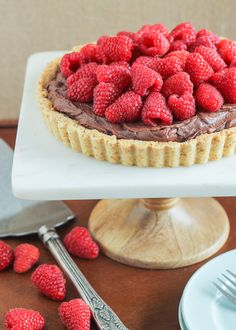 This Whipped Chocolate Ganache Raspberry Tart has an almond flour crust filled with creamy chocolate ganache topped with fresh raspberries! It's naturally gluten free.