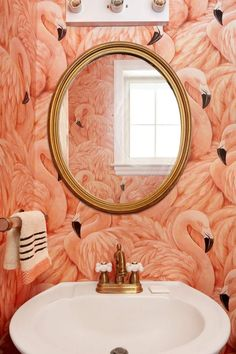 I'm totally in love with this Flamingo wallpaper! It looks super gorgeous paired w/ that white porcelain sink & gold round mirror in this bathroom!