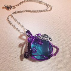 Sold. Purple and teal wire wrapped glass pendant. Www.etsy.com/shop/BlackRoseChris