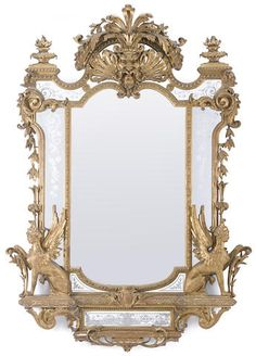 An imposing Napoleon III carved giltwood and gesso mirror late 19th century