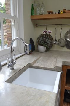 Polished concrete worktop with sloped drainer  www.arnoldskitchens.co.uk