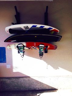 The wake & surf board rack is mounted and the board are off the floor.