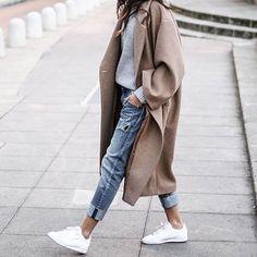 White sneakers + blue jeans + long camel coat + grey sweater https://bellanblue.com