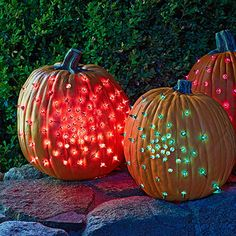 Welcome costumed kids with these faux pumpkins decorated with lights that you can use from year to year.